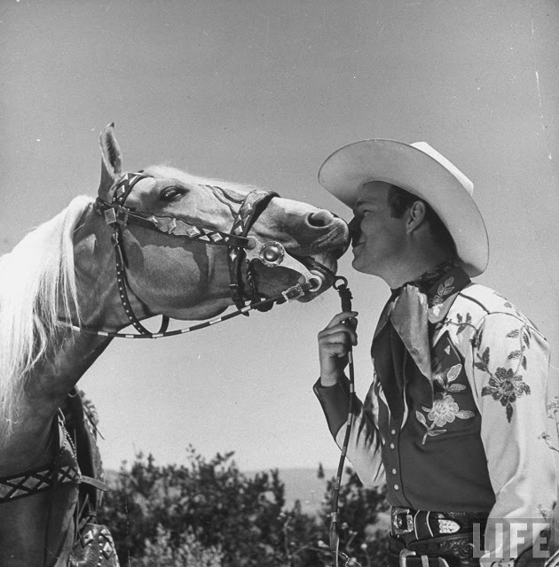 Trigger kissing Roy Rogers.