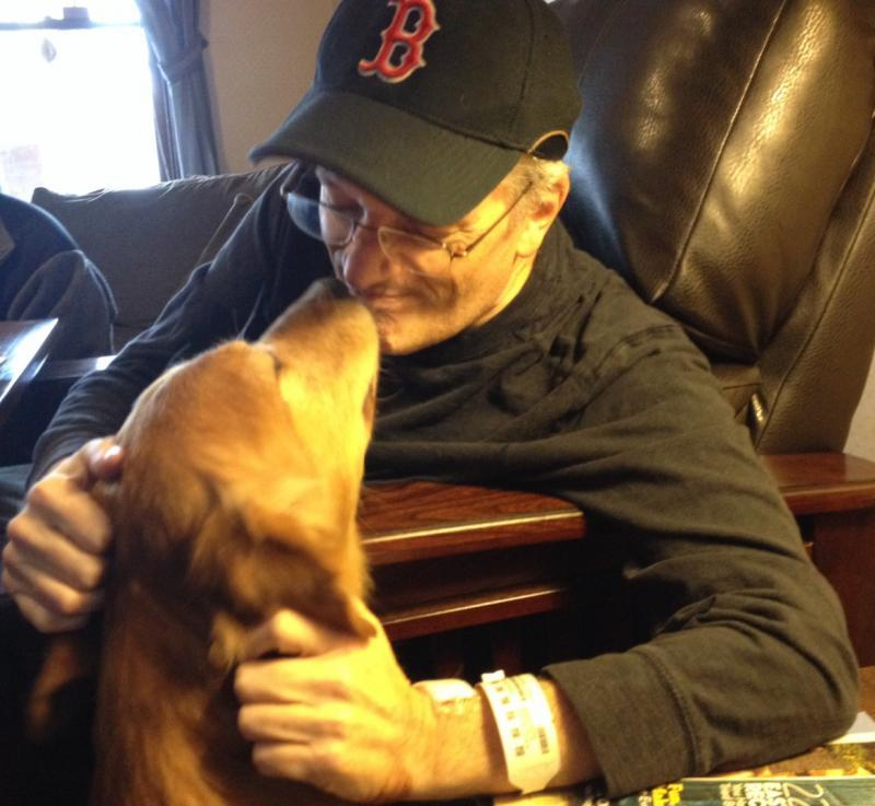 Ike Greets Dad After Hospital Stay 2-19-14 - cropped.jpg